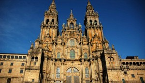 Front of Cathedral of Santiago de Compostela (Galicia-Spain) in the Obradoiro Square. Construction of the present cathedral began in 1075 under the reign of Alfonso VI of Castile (1040-1109) and the patronage of bishop Diego PelA!ez. It was built according to the same plan as the monastic brick church of Saint Sernin in Toulouse, probably the greatest Romanesque edifice in France. It was built mostly in granite. Construction was halted several times and, according to the Liber Sancti Iacobi, the last stone was laid in 1122. But by then, the construction of the cathedral was certainly not finished. The cathedral was consecrated in 1128 in the presence of king Alfonso IX of Leon. (More information in Wikipedia)